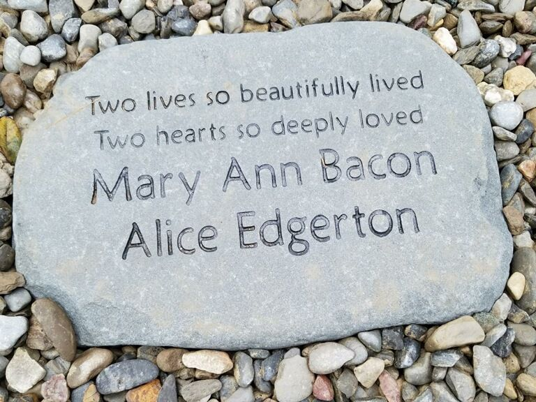 a flat stone engraved with the words: Two lives so beautifully lived, two hearts so deeply loved: Mary Ann Bacon, Alice Edgerton